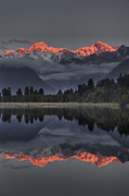 Snow-covered Landscape Posters - Sunset Reflection Of Lake Matheson Poster by Colin Monteath