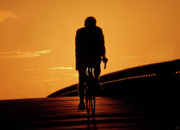 Bicycling Photos - Sunset Ride by David Lee Thompson