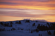 Winter Scenes Photos - Sunset Sky Over Snowy Hills Cast by Raymond Gehman