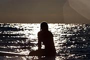 Surf Silhouette Posters - Surfer girl waiting for a wave Poster by Purcell Pictures