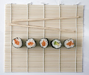 Sushi Posters - Sushi And Chopsticks On A Wooden Mat Poster by Larry Washburn