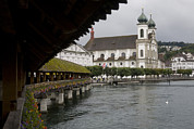 Lucerne Photo Posters - Swans Float Past The Old Town Poster by Taylor S. Kennedy