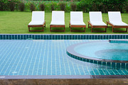 Railing Prints - Swimming Pool And Chairs Print by Atiketta Sangasaeng