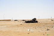 Muammar Gaddafi Prints - T-55 Tanks Destroyed By Nato Forces Print by Andrew Chittock