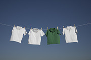 White T-shirt Photos - T-shirts On A Washing Line Against A Blue Sky by Paul Burley Photography