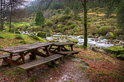 Park Scene Photos - Tables by the River by Carlos Caetano