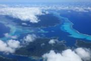 Tahiti Reefs From The Air Print by Owen Ashurst
