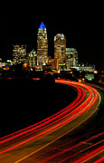 Uptown Charlotte Framed Prints - Taillights toward Charlotte skyline Framed Print by Patrick Schneider