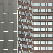 Building Exterior Art - Tall Building And Parallel Lines On It by Olli Kekäläinen