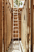 Unfinished Prints - Tall Extension Ladder in an Unfinished Building Print by Skip Nall