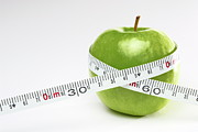 Control Posters - Tape measure round green apple Poster by Sami Sarkis