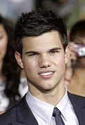 Moon Smiling Framed Prints - Taylor Lautner At Arrivals For The Framed Print by Everett
