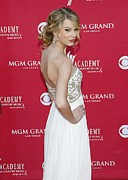 Diamond Earrings Framed Prints - Taylor Swift Wearing A Marchesa Gown Framed Print by Everett
