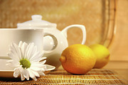 Porcelain Framed Prints - Tea and lemon Framed Print by Sandra Cunningham