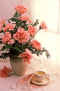 Saucer Prints - Tea cup with pink carnations Print by Garry Gay