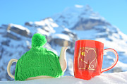 Knitted Dress Posters - Tea pot in the cap and a cup Poster by Alexander Chaikin