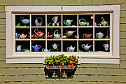 Glass Wall Prints - Tea pots in window Print by Garry Gay
