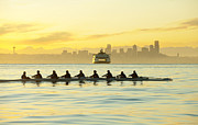 Morning Race Prints - Team Rowing Boat In Bay Print by Pete Saloutos