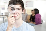 Student Section Photos - Teenage Boy With Magnifying Glass by