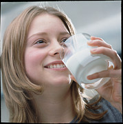 Consume Framed Prints - Teenage Girl Drinking A Glass Of Milk Framed Print by Damien Lovegrove