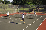 Recreational Structures Posters - Teenagers Play Doubles Tennis Poster by James A. Sugar