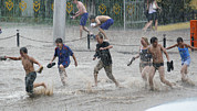 Flooding Photos - Teenagers Playing In Floodwaters by Ria Novosti