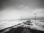 Road Travel Prints - Telephone Poles In Snow Covered Field Print by K.Magnusson