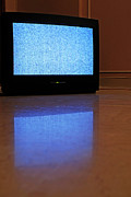 Reflective Art - Television displaying static reflected on floor by Sami Sarkis