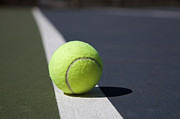 Tennis Ball Photos - Tennis Ball On A Line In A Court by Snap Decision