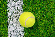 Lawn Tennis Framed Prints - Tennis ball on grass from above. Framed Print by Richard Thomas