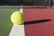 Recreational Park Posters - Tennis Ball Sitting on Court Poster by Thom Gourley/Flatbread Images, LLC