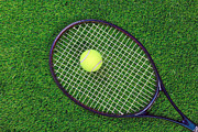Tennis Racket Prints - Tennis raquet and ball on grass Print by Richard Thomas