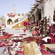 Cushion Metal Prints - Textiles in Qatari souq Metal Print by Paul Cowan