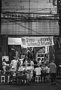 Bangkok Photos - Thai people in front of an old theater at night market by Setsiri Silapasuwanchai
