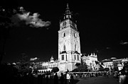 Polish City Prints - The 13th century  Gothic town hall tower with tourists in rynek glowny town square krakow Print by Joe Fox