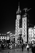 Town Square Prints - The 14th century gothic basilica of the Virgin Mary with tourists in rynek glowny town square krakow Print by Joe Fox
