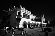 Town Square Prints - The 16th century Cloth Hall Sukiennice building with tourists in rynek glowny town square krakow Print by Joe Fox