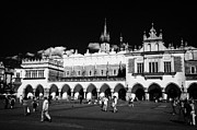 Polish City Prints - The 16th century Cloth Hall Sukiennice building with tourists Print by Joe Fox