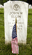Headstones Prints - The American Flag Rests In Front Print by Stocktrek Images