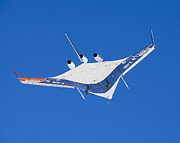 Low Wing Photo Prints - The Blended Wing Body X-48b Soars Print by Stocktrek Images