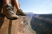 North Rim Posters - The Boot-shod Feet Of A Hiker Dangle Poster by John Burcham