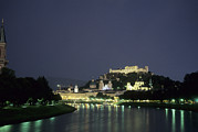 Salzburg Posters - The City Is Illuminated At Night Poster by Taylor S. Kennedy