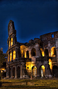 Dark Blue Prints - The Coleseum in Rome at night Print by David Smith