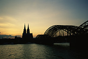 Silhouetted Posters - The Cologne Cathedral And Hohenzollern Poster by Raul Touzon