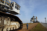 Transporter Prints - The Crawler-transporter Moves Away Print by Stocktrek Images