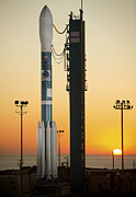 Rocket Boosters Posters - The Delta Ii Rocket On Its Launch Pad Poster by Stocktrek Images