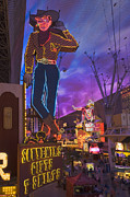 Fremont Street Framed Prints - The Famous Ivegas Vici Neon Cowboy Stands Among Other Signs On Fremont Street In The Iglitter Gulchi Gaming Area Of Las Vegas, Nv Framed Print by David Davis