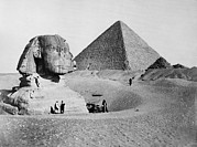 Ancient Sculpture Photos - The Great Sphinx With The Pyramid by Everett