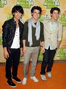 At Arrivals Prints - The Jonas Brothers At Arrivals Print by Everett