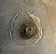 Astrogeology Photos - The Largest Known Volcano In The Solar by Stocktrek Images